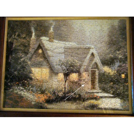 Diane Lane's (USA) repaired jigsaw Cedar Nook Cottage by Thomas Kinkade (Ceaco)
