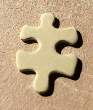 Replacement jigsaw puzzle piece awaiting its image to be applied